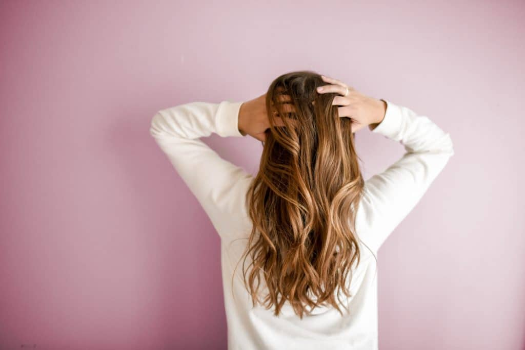 Strengthen your hair with a coconut oil treatment.